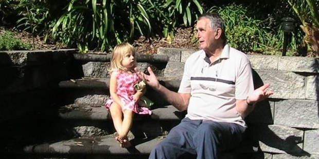 HAPPINESS IS: Tom Young spinning a yarn to his first (long-awaited and adored) grandchild Grace. PICTURE/THE YOUNG FAMILY