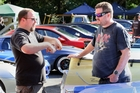 Daniel Yorke and Chris Ace surrounded by amazing cars.
