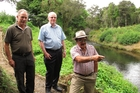 Northland regional councillor Joe Carr, chairman Bill Shepherd and councillor Dover Samuels visit a stretch of Kerikeri River near the site of a planned spillway designed to protect homes from floods while inundating farmland. Photo / Peter de Graaf