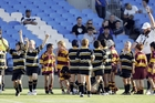 Age-group players at the end of a Super Rugby curtain-raiser at Eden Park. The big attraction has been part of the problem. Photo / Photosport
