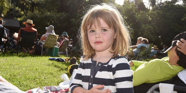 Sylvia Mayston, 3, listening to the music at Te Puna Quarry Park.