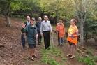 John Horrell, a volunteer gardener, explains plans for an expanded Roland's Wood to mayor John Carter, council staff, councillor Ann Court and neighbour Vivian Thonger. Photo / Peter de Graaf