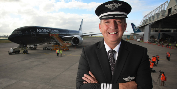 Air New Zealand's chief pilot Captain David Morgan with Air New Zealand's newest Boeing 777-300ER. Photo / Greg Bowker