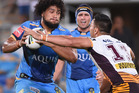 Leivaha Pulu of the Titans runs with the ball during the round five NRL match between the Gold Coast Titans. Photo / Getty images.