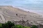 With just a rake as a paintbrush a visiting artist created a stunning work of art on a Mount Maunganui beach. Andres Amador, an artist from San Francisco, drew an intricate piece of art on the sand, with help from local ta moko artist Pohe Luttenberger... only for it to be lapped away by the incoming tide.