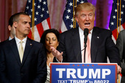 Trump's campaign manager Corey Lewandowski listens as Trump speaks in Florida. Police have charged Lewandowski with assault. Photo / AP