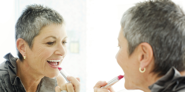 Using a lip liner can make lips, which thin with age, appear fuller. Photo / Getty