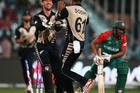 Luke Ronchi congratulates Black Caps bowler Ish Sodhi after he bowled Mahmudullah of Bangladesh. Photo/Getty.