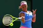 Svetlana Kuznetsova plays a semifinal against Timea Bacsinszky at the Miami Open. Photo / Getty Images