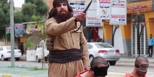 This man has been seen executing three prisoners in the latest Islamic State propaganda video. Photo / Supplied