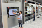The new touchscreen shop window allows customers to look through multiple properties day and night.
