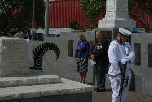 Minister for Land Information and Associate Minister for Local Government Louise Upston stands with head bowed alongside MC Terrence McConnell at the base of the Angel memorial after its re-dedication last week in Kaitaia. Photo / Mike Barrington