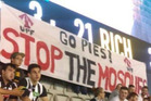 Anti-Muslim banner at Collingwood-Richmond AFL match, unfurled by members of the United Patriots Front. Photo / Twitter.