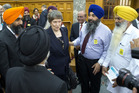 United Nations Development Programme head Helen Clark with a group of Sikhs after opening the Religious Diversity Centre at Parliament. Photo / Mark Mitchell