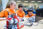 Team Antimatter (from left) Amy White, Harry White and Tim Harrington work on their robot, Erupter. Photo / Nick Reed