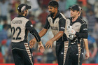 New Zealand's Ish Sodhi, centre, is congratulated by teammates for the dismissal of Abu Hider Al-Amin Hossain. Photo / AP.