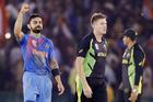 India's Virat Kohli, left, celebrates as he walks with Australia's James Faulkner after winning their ICC World Twenty20 2016 cricket match. Photo / AP.