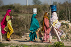 In parts of Asia and Africa, women and girls walk about 6km a day to collect water. Photo / AP