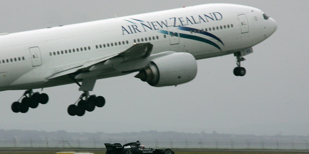 A1GP driver Jonny Reid in Black Beauty (the A1 Team NZL race car) races the Air New Zealand Boeing 777-200 piloted by Captain Dave Morgan. Photo / File
