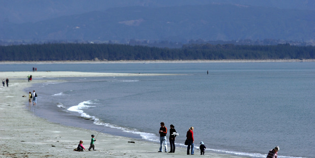 Tahuna beach with Mt Arthur in the distance in Nelson. Photo / Tim Cuff