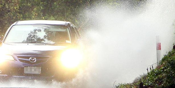 Heavy rain floods road in Rotorua. 16 March 2014 Rotorua Daily Post Photograph by Ben Fraser