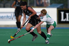 New Zealand player, Lisa Walton competes for the ball with Jill Orbinson during the Olympic Hockey Qualifier match between the New Zealand Black Sticks and Ireland played at Lloyd Elsmore Park in 2004.