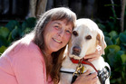 Whangarei woman Mhairi Collins with her guide dog Peace, who has opened up her world. Photo / John Stone