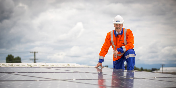 Unison Networks chief executive Ken Sutherland is pictured with solar panels, which will cost more to run from today. Photo John Cowpland/Alphapix