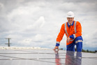 Unison Networks chief executive Ken Sutherland is pictured with solar panels, which will cost more to run. Photo John Cowpland/Alphapix