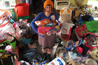 Monika Welch surrounded by food and clothes destined for needy families. PHOTO / PETER DE GRAAF