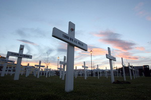 The sun goes down on the 304 white crosses raised in remembrance of each fallen soldier from the Masterton district in World War I, Town Square, Masterton