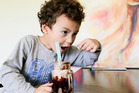 Ihaia Morrell, 3, enjoys the best chocolate milkshake in New Zealand, made by his mum, Tessa Flowers-Morrell, at Lulu and Max cafe in Hastings. Photo / Warren Buckland