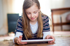 Research shows that 75 to 80 per cent of parents use technology to placate or distract children. Photo / Getty Images