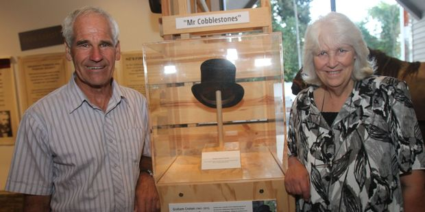 Cobblestones Trust chairman Graeme Gray, left, and Wendy Croton remember Graham Croton with a memorial display centred around his top hat at the Cobblestones Museum in Greytown. PHOTO/ANDREW BONALLACK