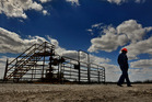 Swift Energy chief Terry Swift walks the grounds at a company drilling site in Tilden, Texas. Washington Post photo / Michael S. Williamson