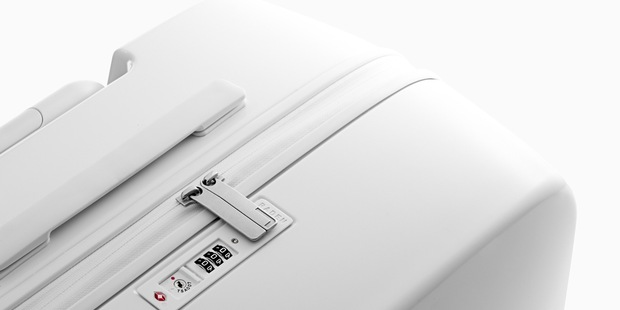 A Raden suitcase featuring TSA-approved locks, built-in USB ports for chargers and Bluetooth technology.