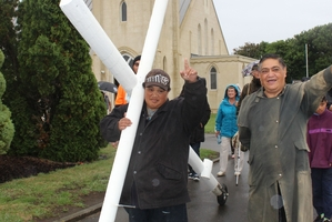 Rain didn't deter Peter Tairea (carrying the cross) and Tom Kamura, leading the faithful from Dannevirke's St John the Baptist Anglican Church during Good Friday's cross walk.