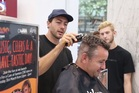 Farmers on Queen St hosted the Leukaemia & Blood Cancer New Zealand event which saw the original Bachelor New Zealand Art Green shaving the heads of volunteers. Photo / Michael Craig