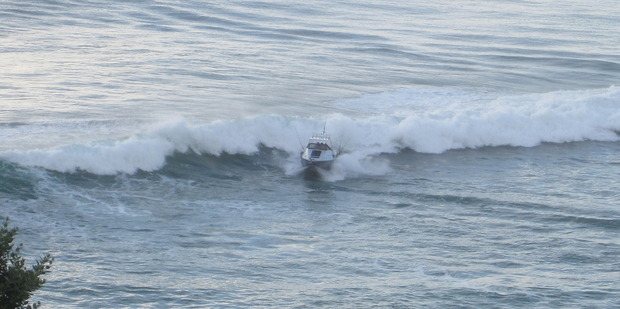 The wave swamps the boat.