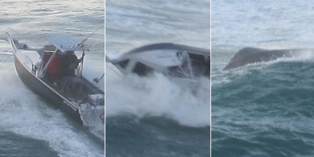 The fishing boat is flipped over by a freak wave as it tried to cross Coromandel's Tairua Bar. Photos / Tim Hunt
