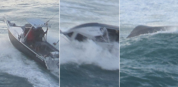 The fishing boat is flipped over as it tried to cross Coromandel's Tairua Bar. Photos / Tim Hunt
