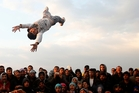 The future may be up in the air for migrants at the northern Greek border station of Idomeni but they still find ways to entertain themselves. Photo / AP