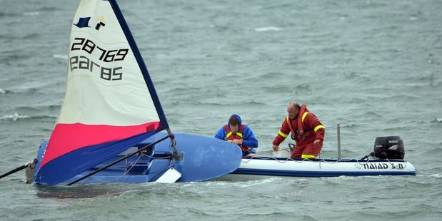 Thomas George spent 40 minutes in the Otago Harbour this morning after capsizing his yacht before being rescued by his father. Photo / Stephen Jaquiery