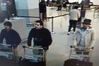 Najim Laachraoui (left) and Ibrahim El Bakraoui are shown in CCTV footage wearing one glove but authorities are still searching for the man in the hat. Picture / AP