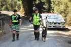 Sergeant Craig Burrows of Kamo police and Constable Tony Harris of Auckland emerge after searching the bush with Phoenix, a police dog trained to locate bodies. Photo / Peter de Graaf