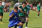Jerahl Hughes (left) tussles with Onehunga's Kyosuke Kitand in Tauranga City United's season opening win. Photo / Stuart Whitaker