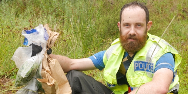 Constable Andrew Hunter with samples after more than 10 hours in the bush hunting for cannabis plants.