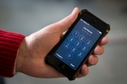 It seems there is a way to unlock iPhones after all. Picture / AP