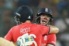 England's Jos Buttler, right, embraces teammate Joe Root after defeating New Zealand. Photo / AP