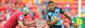 Israel Folau on the burst against the Reds. Photo / Getty